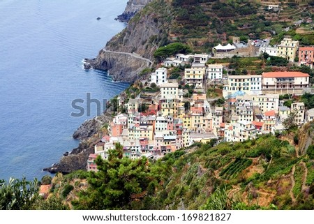 Coast and cliffs of the Riomaggiore village - stock photo