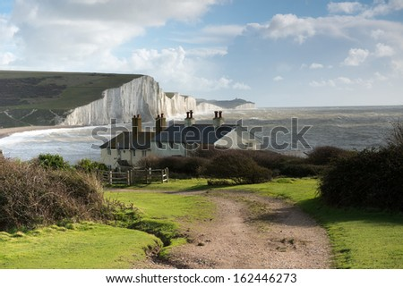 Coast Guard Cottages & Seven Sisters just outside Eastbourne, England - stock photo