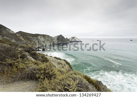 Coast of Big Sur with cloudy sky. USA. California. - stock photo