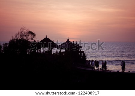 Coast of Indian ocean on sunset.  Bali, Indonesia - stock photo