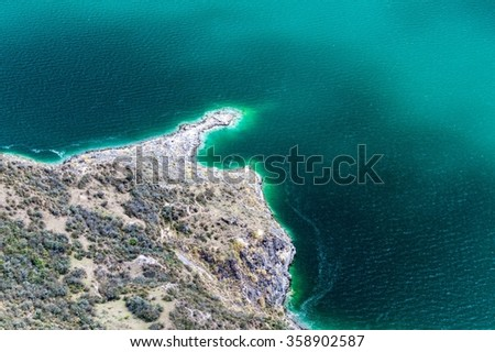 Coast of laguna Quilotoa - volcanic crater lake in Ecuador - stock photo