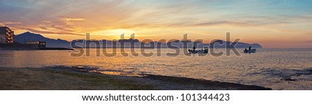 Coast of Sicily and cloudscape with the boats on Mediterranean sea. - stock photo