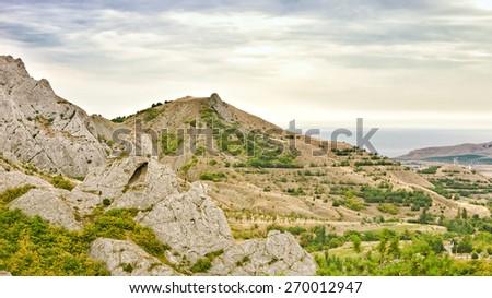 Coast of the Black Sea in cloudy weather, Crimea - stock photo