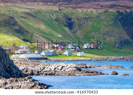 Coast village on Runde in Norway - stock photo