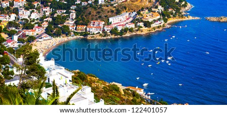 Coast with the people on the beach on a sunny day (Spain, Catalonia, Costa Brava) - stock photo