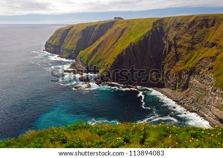 Coastal cliffs on Cape St Mary in Newfoundland - stock photo