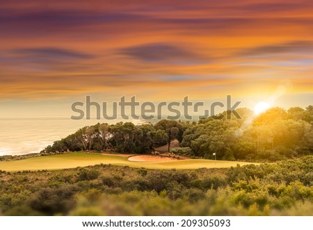 Coastal Golf Course at Sunset - stock photo