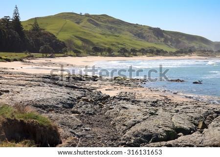 coastal landscape, clear blue day, Pouawa, Gisborne, East Coast, North Island, New Zealand  - stock photo