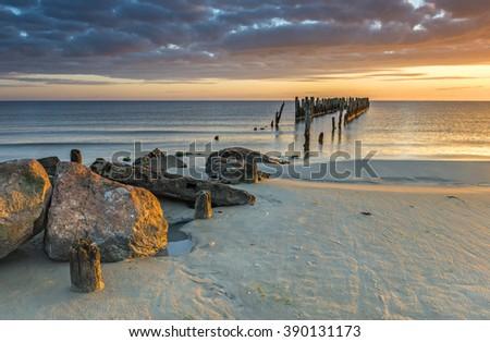 Coastal landscape with old broken fishery wharf, Baltic Sea - stock photo