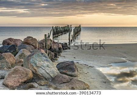 Coastal landscape with old fishing wharf, Baltic Sea, Latvia - stock photo