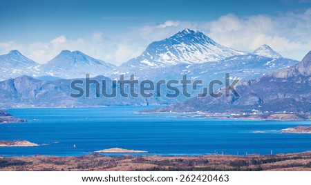 Coastal Norwegian mountain landscape with sea and fjords - stock photo