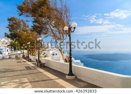 Coastal promenade with view of caldera in Firostefani village on Santorini island, Greece - stock photo