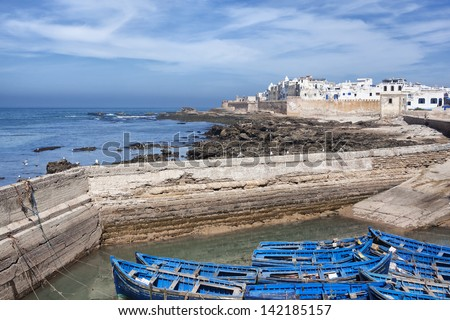 Coastal town Essaouira with sea and blue boats in Morocco. - stock photo