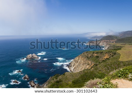 Coastline in California with dramatic rocks and cliffs alongside highway 1 - stock photo