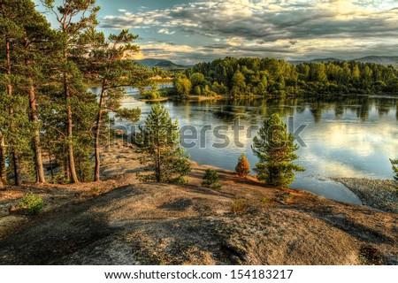 Coastline of Biya river in Turochak village (Russia, Altay Republic) - stock photo