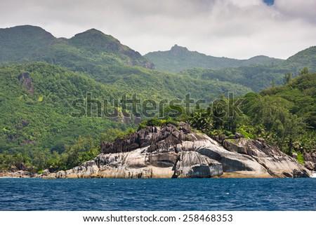 Coastline of Mahe island, Seychelles in january overcast day - stock photo