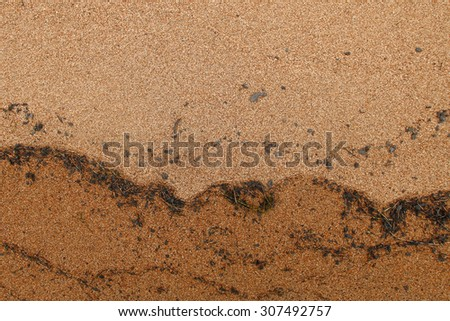 Coastline. Stains from water on the sand - stock photo