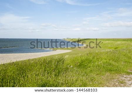 Coastline with dike in Zeeland, Holland - stock photo