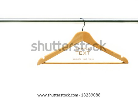 Coat hanger on clothes a rail against white - stock photo