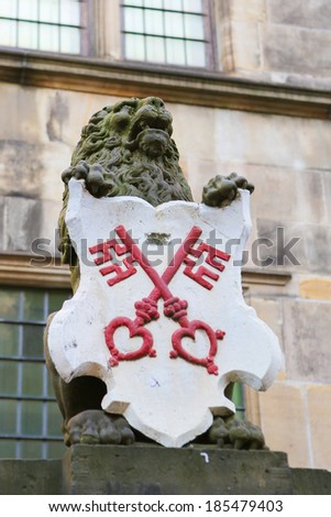 Coat of arms with the two keys at the town hall of Leiden, The Netherlands. - stock photo