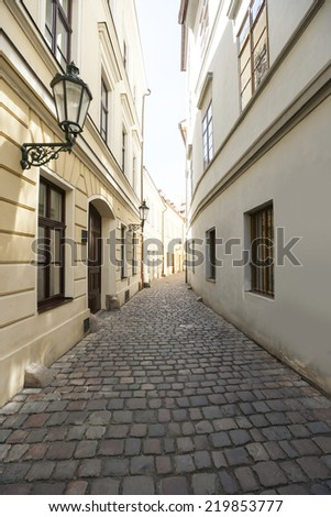 Cobbled alleyway of old city; Prague; Czech Republic - stock photo