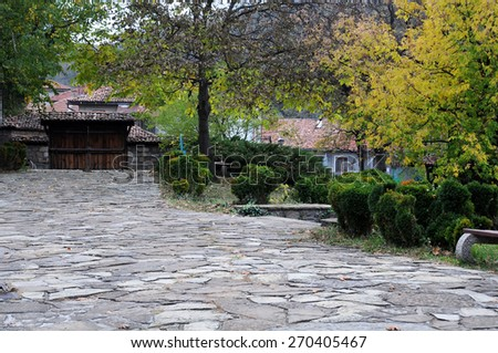 Cobbled courtyard in Bulgaria in the fall - stock photo