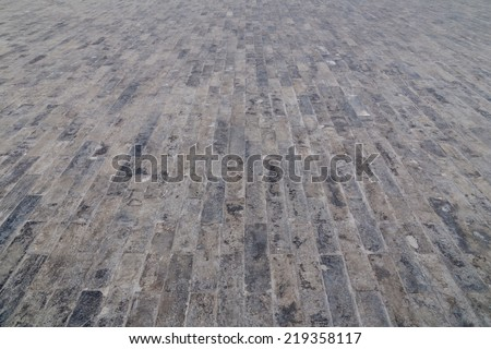 Cobbled road as background. - stock photo
