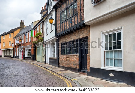 Cobbled streets and pretty cottages at Norwich in Norfolk - stock photo