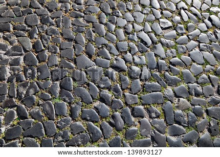 cobblestone pavement as background texture - stock photo