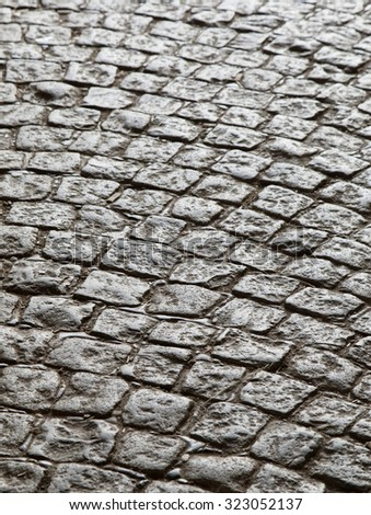 Cobblestone pavement shot from low viewpoint, background - stock photo