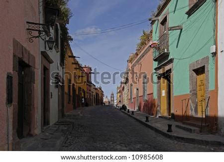 Cobblestone street in San Miguel de Allende, Mexico - stock photo