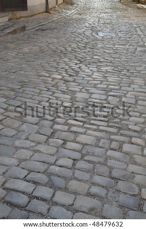 Cobblestones road. - stock photo