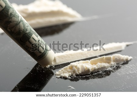 Cocaine and 10 dollars note - stock photo