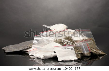 Cocaine and marihuana in packages on grey background - stock photo