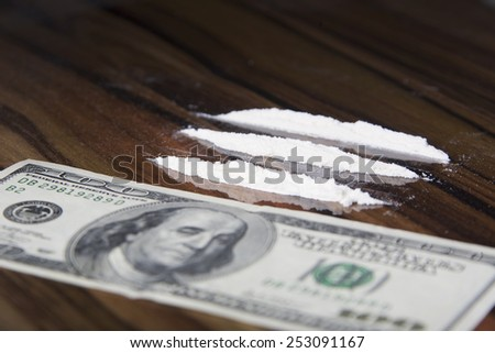 Cocaine and one hundred dollar bill - stock photo