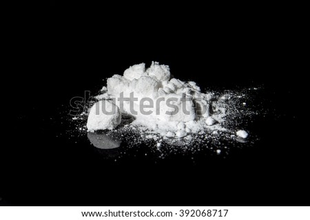 Cocaine on a black background - stock photo
