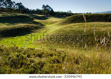 Cochasqui flat-tapped pyramids, archaeological site, with Cotopaxi volcano in the background, Ecuador, South America - stock photo
