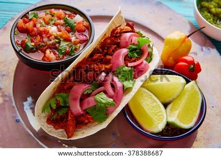 Cochinita Pibil Mexican food with pico de gallo lemon and chili - stock photo