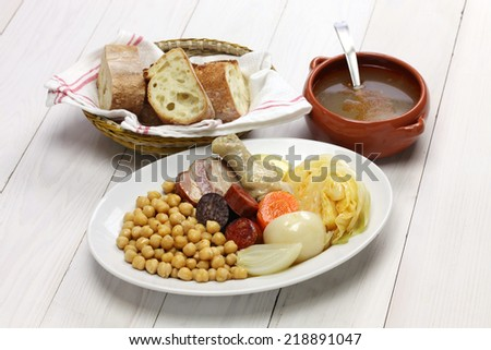 cocido madrileno, chickpea and pork stew, spanish cuisine - stock photo