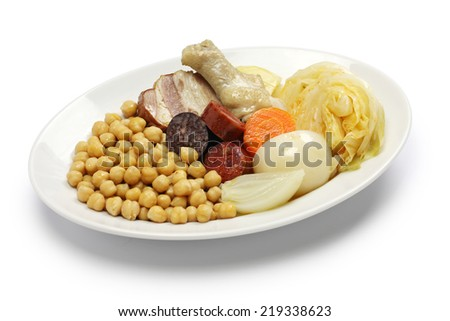 cocido madrileno, chickpea and pork stew, spanish cuisine isolated on white background - stock photo