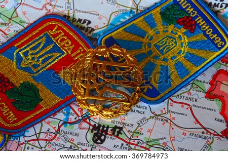 Cockade of Ukrainian Army. Eastern Ukraine map with site of MH-17 flight crash as background. At January 31,2016 in Kiev, Ukraine - stock photo
