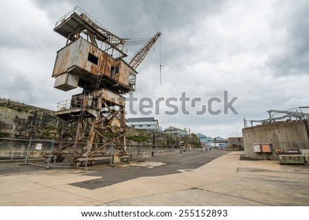 COCKATOO ISLAND, SYDNEY, AUSTRALIA - DECEMBER 28, 2014: Rusty disused crane on Cockatoo Island, once a busy ship yard and former prison, now a popular tourist attraction in Sydney. In December 2014. - stock photo
