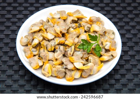 cockles and clams on a plate ready to eat - stock photo