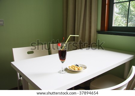 cocktail and cookies on the white table. - stock photo