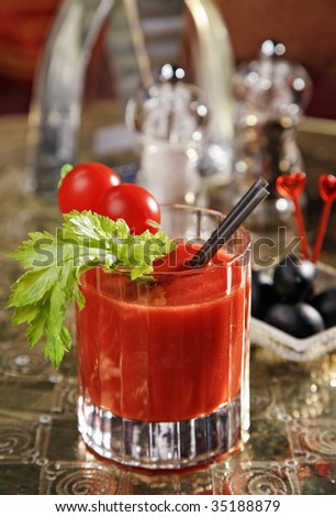 Cocktail Bloody Mary decorated on a gold tray - stock photo