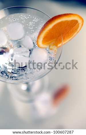 cocktail decorated with an orange slice - stock photo