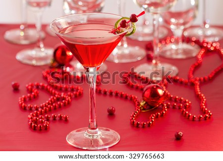 Cocktail drink on cranberries - stock photo