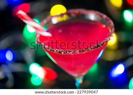 Cocktail for Christmas: Vodka infused with candy cane and glass rimmed with chocolate and crushed candy cane. Great for entertaining! - stock photo