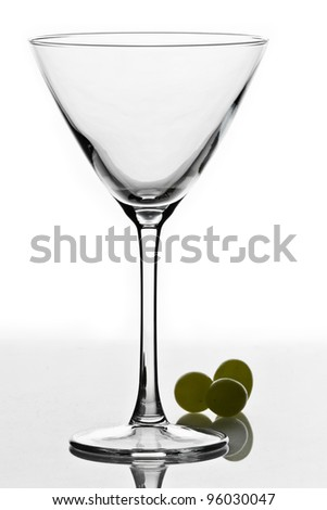 cocktail glass isolated on white ground with three green grapes - stock photo