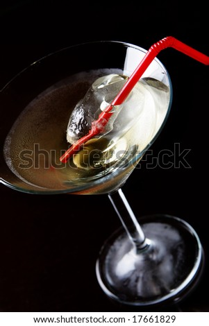 Cocktail glass with ice and olive close-up viev from above - stock photo